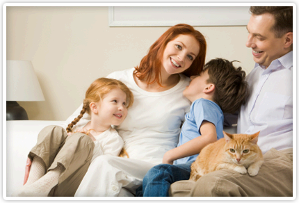 Happy Family relaxing on couch with cat
